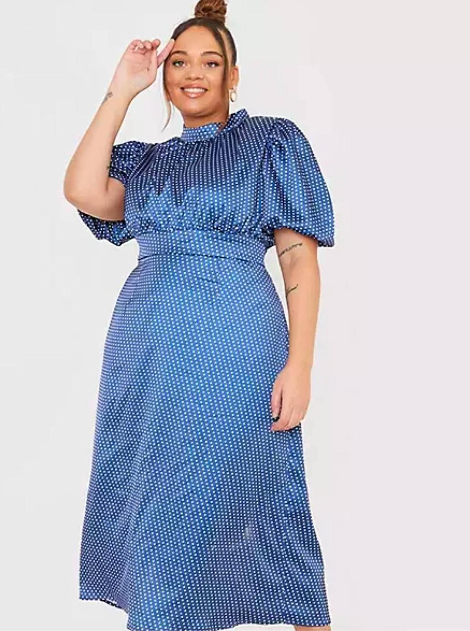 """Baby polka dots forever. $58, ASOS. <a href=""""https://www.asos.com/us/in-the-style-plus/in-the-style-plus-x-lorna-luxe-puff-sleeve-midi-dress-in-navy-polka-dot-print/prd/22638027"""" rel=""""nofollow noopener"""" target=""""_blank"""" data-ylk=""""slk:Get it now!"""" class=""""link rapid-noclick-resp"""">Get it now!</a>"""