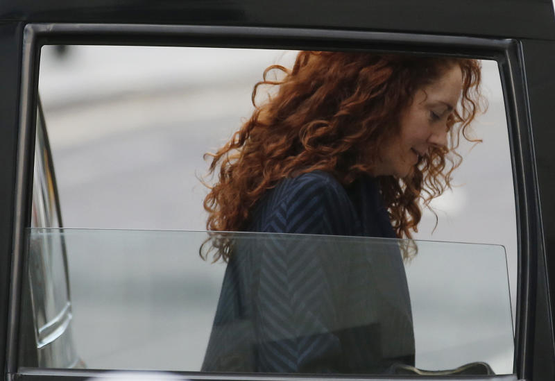 Rebekah Brooks, former News International chief executive, arrives at the Central Criminal Court in London where she appear to face charges related to phone hacking, Wednesday, Feb. 19, 2014. Almost four months into her trial, Brooks is finally getting her day in court. After watching in silence from the dock as her alleged crimes were dissected, the 45-year-old former newspaper editor, once Rupert Murdoch's top British lieutenant, is expected to take the stand to rebut charges of phone hacking, bribery and obstructing a police investigation. (AP Photo/Sang Tan)