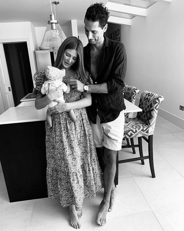 """<p>Four weeks after welcoming their baby girl, Millie Mackintosh and Hugo Taylor shared the first picture of the newborn, and later revealed they had named her Sienna Grace.</p><p>'The first four weeks of your life have been the best four weeks of mine,"""" the new mum wrote. """"Thank you for making me a Mummy darling girl 💗.'</p><p>Former MIC stars Millie and Hugo welcomed their daughter on May 1. 'We are delighted to announce the arrival of our darling girl who arrived on Friday 1 May at 1:21pm, weighing a very healthy seven pounds,' they told <a href=""""https://www.hellomagazine.com/"""" rel=""""nofollow noopener"""" target=""""_blank"""" data-ylk=""""slk:Hello"""" class=""""link rapid-noclick-resp"""">Hello</a> magazine at the time. </p><p>'We are eternally grateful to the doctors, nurses and midwives for taking such good care of us. Mum and baby are both doing incredibly well and we are looking forward to bringing our daughter home and spending time together as a family.'<br></p><p><a href=""""https://www.instagram.com/p/CAw3EPTnT49/"""" rel=""""nofollow noopener"""" target=""""_blank"""" data-ylk=""""slk:See the original post on Instagram"""" class=""""link rapid-noclick-resp"""">See the original post on Instagram</a></p>"""