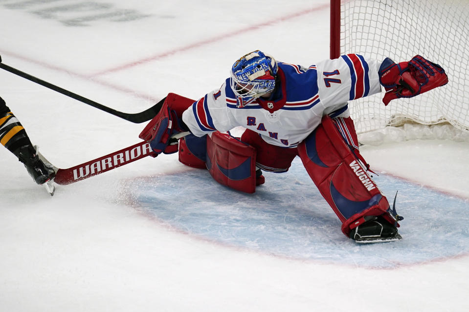 New York Rangers goaltender Keith Kinkaid (71) makes a save on a shot by Boston Bruins right wing David Pastrnak (88) during the third period of an NHL hockey game, Saturday, May 8, 2021, in Boston. Kinkaid left the game after the save with an apparent injury. (AP Photo/Charles Krupa)