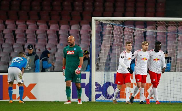 Soccer Football - Europa League Round of 32 First Leg - Napoli vs RB Leipzig - Stadio San Paolo, Naples, Italy - February 15, 2018 RB Leipzig's Timo Werner celebrates scoring their third goal with team mates as Napoli's Pepe Reina looks dejected REUTERS/Tony Gentile