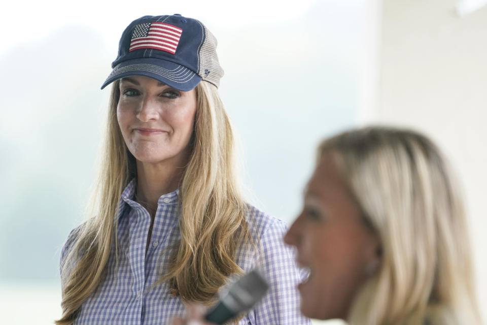 Sen. Kelly Loeffler, R-Ga., listens to Republican congressional candidate Marjorie Taylor Greene speak during a news conference on Thursday, Oct. 15, 2020, in Dallas, Ga. (AP Photo/Brynn Anderson)