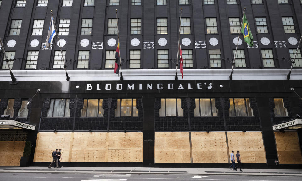Bloomingdale's department store has boarded-up windows, Thursday, June 11, 2020 in New York. The store is open for curbside pickup. In the virus times, the near-term and maybe even longer-term impact is undoubtedly going to be ugly. Job losses have been racking up, businesses facing bankruptcy, cultural institutions going under, entire industries like restaurants forced to reconsider everything they do.(AP Photo/Mark Lennihan)