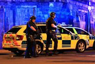 <p>Armed police work at Manchester Arena after reports of an explosion at the venue during an Ariana Grande gig in Manchester, England Monday, May 22, 2017. Several people have died following reports of an explosion Monday night at an Ariana Grande concert in northern England, police said. A representative said the singer was not injured. (Peter Byrne/PA via AP) </p>
