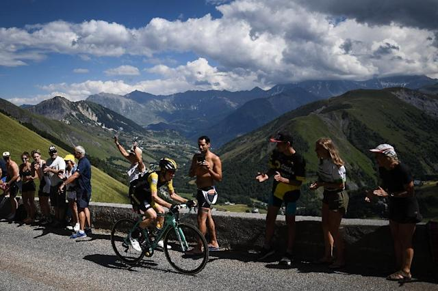 Dutchman Steven Kruijswijk racing up the Col de la Croix de Fer climb in a futile bid for a famous stage win at l'Alpe d'Huez. (AFP Photo/Jeff PACHOUD)