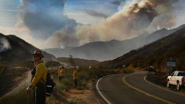 PHOTO: Huge smoke clouds rise into the sky at the Thomas fire, Dec. 9, 2017 at Los Padres National Forest in California. (Gene Blevins/Polaris)