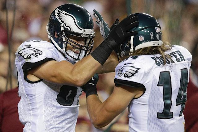 Philadelphia Eagles tight end Brent Celek, left, celebrates his touchdown with teammate wide receiver Riley Cooper during the first half of an NFL football game against the Washington Redskins in Landover, Md., Monday, Sept. 9, 2013. (AP Photo/Alex Brandon)