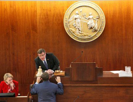 Speaker of the North Carolina House of Representatives Tim Moore (C) confers with a colleague as the chamber convenes to consider repealing the controversial HB2 law limiting bathroom access for transgender people in Raleigh, North Carolina, U.S. on December 21, 2016. REUTERS/Jonathan Drake