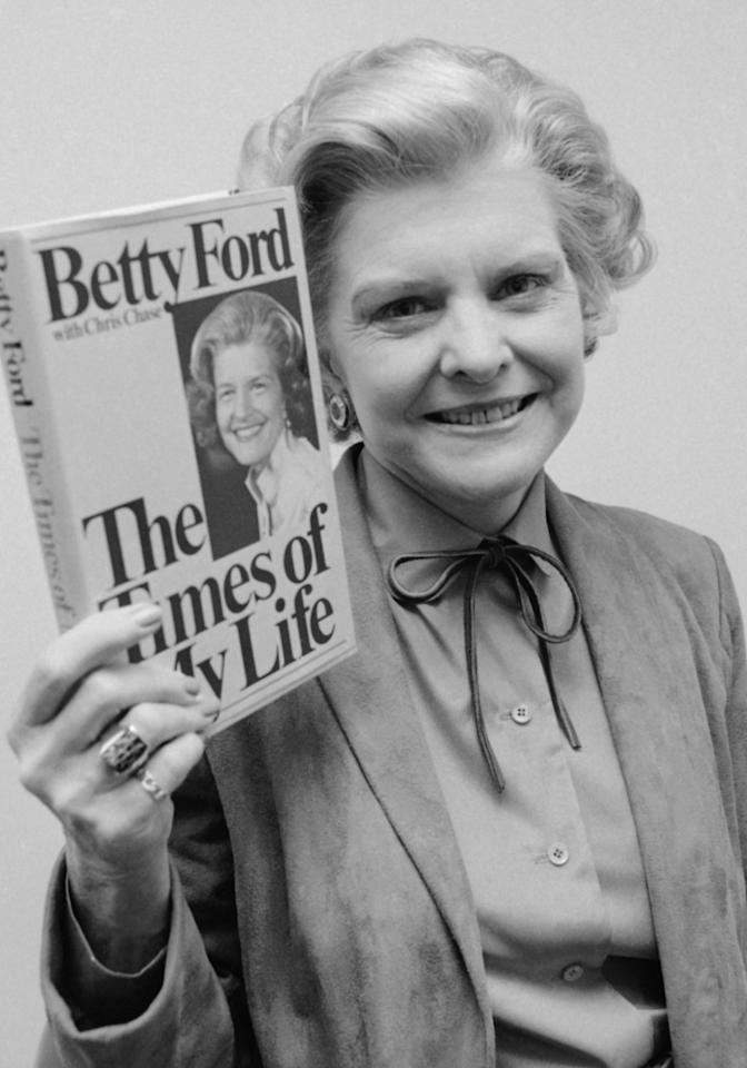 "FILE - In this Nov. 9, 1978 file picture, former first lady Betty Ford holds her newly-released book, ""The Times of My Life,"" in New York. Ford, the former first lady whose triumph over drug and alcohol addiction became a beacon of hope for addicts and the inspiration for her Betty Ford Center, has died, a family friend said Friday, July 8, 2011. She was 93. (AP Photo/Dave Pickoff)"
