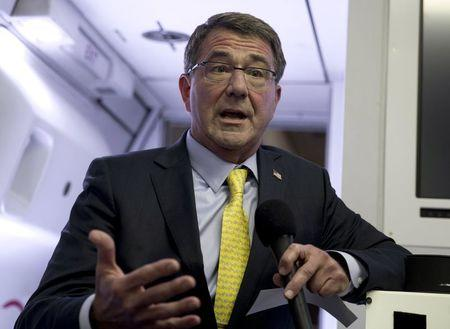 U.S. Defense Secretary Ash Carter talks with members of the media on a military aircraft en route to Amman, Jordan, after departing Jeddah, Saudi Arabia