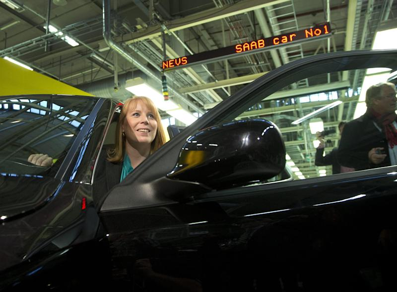 Swedish Minister of Trade, Annie Loof, looks out from the first production Nevs (National Electric Vehicle Sweden) Saab 9-3 Aero at the Trollhattan factory in Sweden, Monday, Dec. 2, 2013. NEVS bought the remains of Swedish car maker SAAB and is focusing on electric vehicles. However the first car to leave the factory after it was restarted is a gasoline fueled 220 horsepower 2.0-liter turbo. (AP Photo/TT, Bjorn Larsson Rosvall) SWEDEN OUT