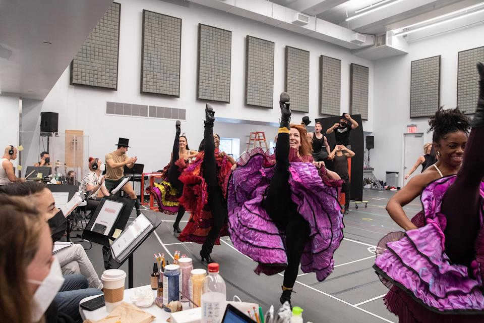 Ensemble members doing the can-can during the <i>Moulin Rouge! The Musical</i> run-through in the studio on Sept. 12, 2021.
