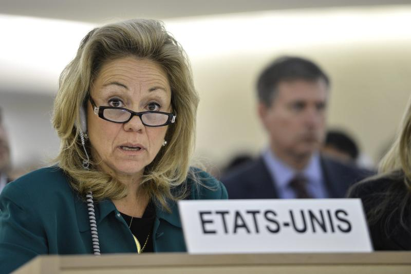 Eileen Chamberlain Donahoe, U.S. Representative to the Human Rights Council, listens before the vote after the Syria draft resolution was just adopted by the Council during the 21th session of the Human Rights Council at the European headquarters of the United Nations in Geneva, Switzerland, Friday, Sept. 28, 2012. The U.N.'s top human rights body on Friday extended by six months the mission of its independent expert panel probing alleged war crimes in Syria's 18-month conflict. (AP Photo/Keystone, Martial Trezzini)