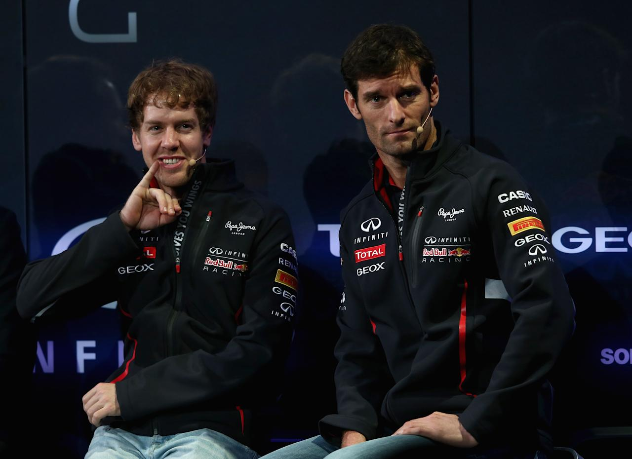 MILTON KEYENES, ENGLAND - FEBRUARY 03:  Drivers Sebastian Vettel of Germany (L) and Mark Webber of Australia talk to the guests during the Infiniti Red Bull Racing RB9 launch on February 3, 2013 in Milton Keynes, England.  (Photo by Getty Images/Getty Images)