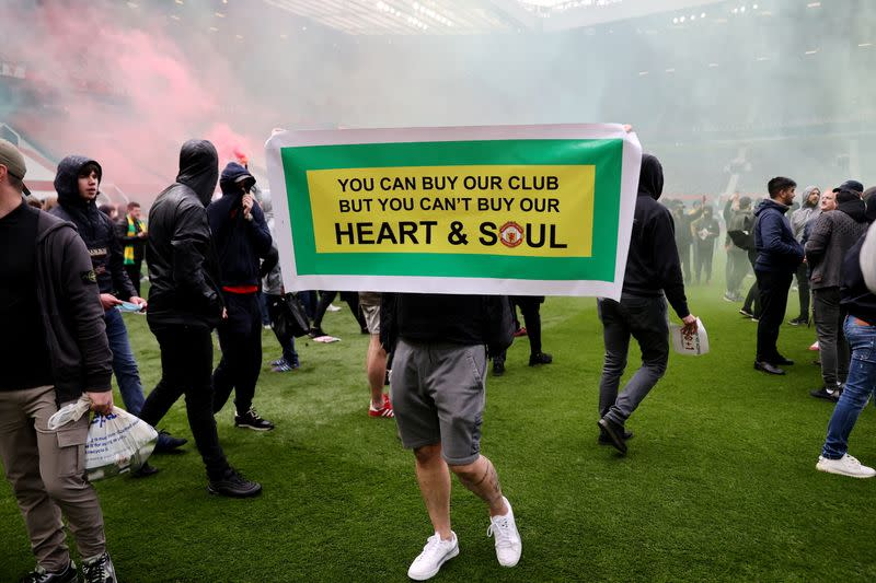 Manchester United fans protest against their owners before the Manchester United v Liverpool Premier League match