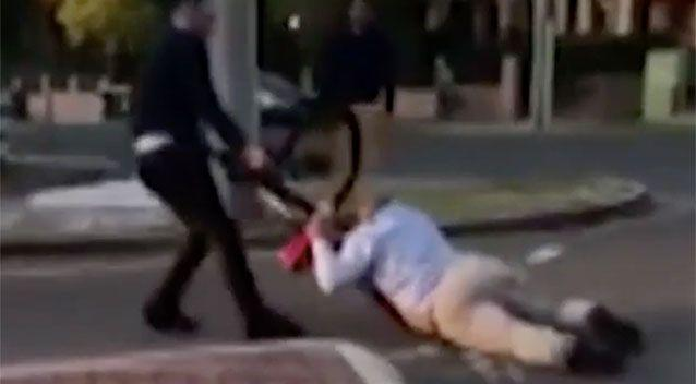 The man is dragged along the ground on his stomach. Source: 7 News