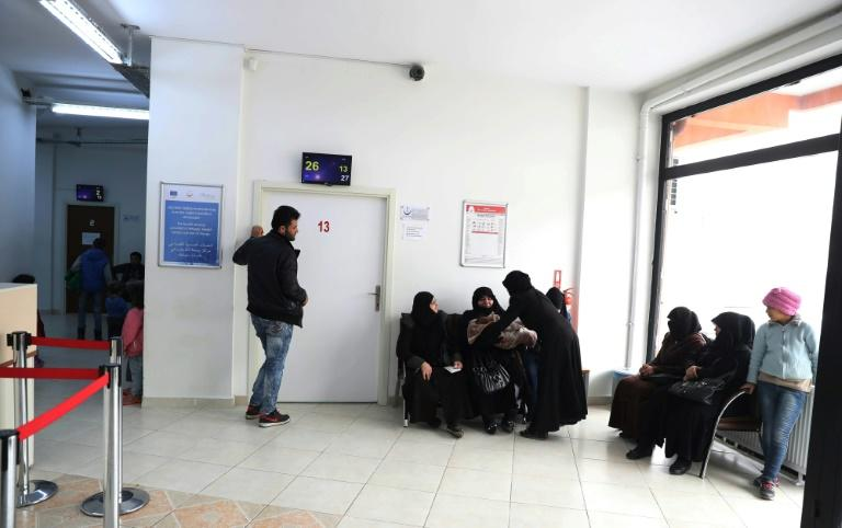 Syrian doctors and nurses, who have fled the conflict in their homeland, undergo seven weeks of training in Turkey before being authorised to resume their careers and work in a migrant health centre