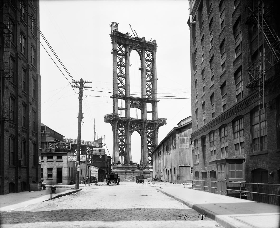 In this June 5, 1908 photo provided by the New York City Municipal Archives, the superstructure from the Manhattan Bridge rises above Washington Street in New York. Over 870,000 photos from an archive that exceeds 2.2 million images have been scanned and made available online, for the first time giving a global audience a view of a rich collection that documents life in New York City. (AP Photo/New York City Municipal Archives, Department of Bridges/Plant & Structures, Eugene de Salignac) MANDATORY CREDIT