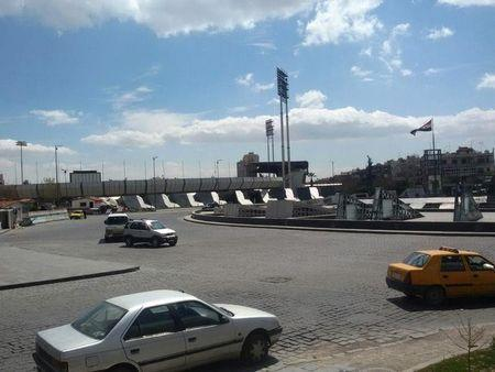 Vehicles drive at Abbasiyin square in the east of the capital Damascus