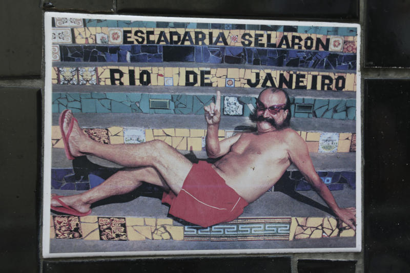 "An undated photo of Chilean artist Jorge Selaron decorates a tile that is part of a wall on a public staircase he decorated and titled the ""Selaron Stairway"" in Rio de Janeiro, Brazil, Thursday, Jan. 10, 2013. Selaron, an eccentric Chilean artist and longtime Rio resident who created a massive, colorful tile stairway in the bohemian Lapa district that's popular with tourists, was found dead on the stairway on Thursday. Authorities are investigating the cause of death. (AP Photo)"