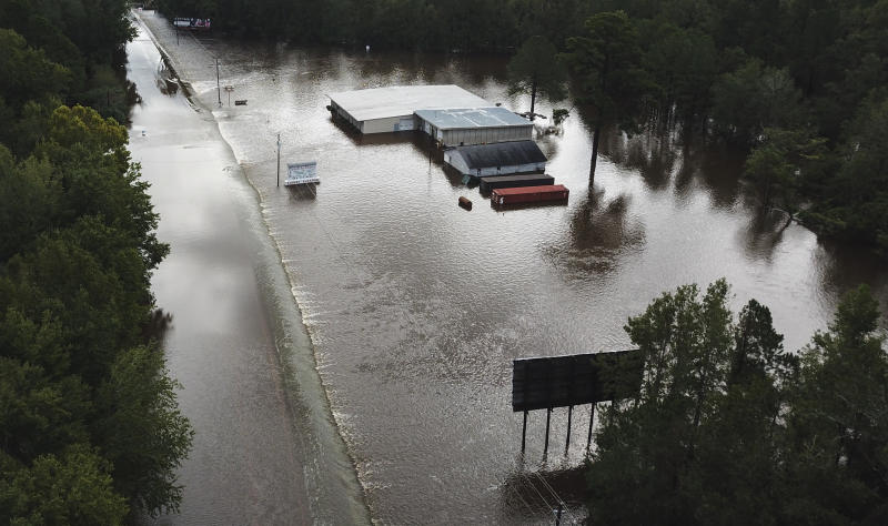 Water from The Little Pee Dee River floods business and washes out part of Rte. 301 on September 17, 2018 in Dillon, S.C. (Photo by Ricky Carioti/The Washington Post via Getty Images)<i></i> (The Washington Post via Getty Images)