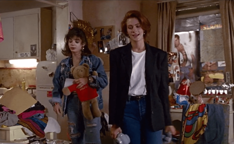 <p>Julia Roberts has too many iconic fashion moments in <em>Pretty Woman</em> to count. But the belted, medium wash, high-waisted jeans she sports at the end of the film is impossibly chic and simply unforgettable. </p>