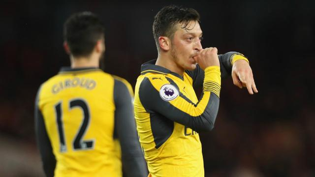 Alexis Sanchez and Mesut Ozil gave Arsenal a 2-1 win over Middlesbrough that lifts them back into the Premier League's top six.