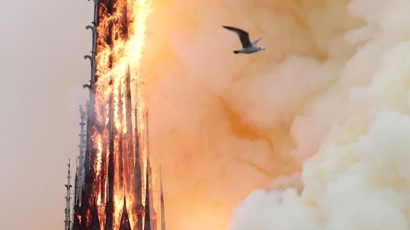 Smoke billows as fire engulfs the spire of Notre Dame Cathedral in Paris, France April 15, 2019.