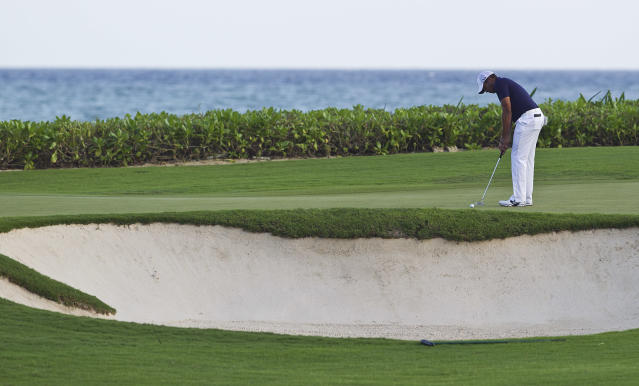 Jhonattan Vegas from Venezuela plays the ball on the fourth green during the third day of the OHL Classic at Mayacoba golf tournament in Quintana Roo, Mexico, Saturday, Nov. 16, 2013. (AP Photo/Christian Palma)