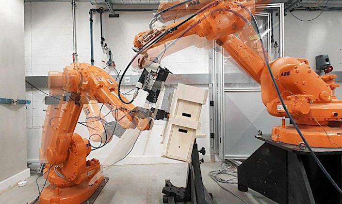 Robots make quick work of assembling the ALIS' plywood modules.