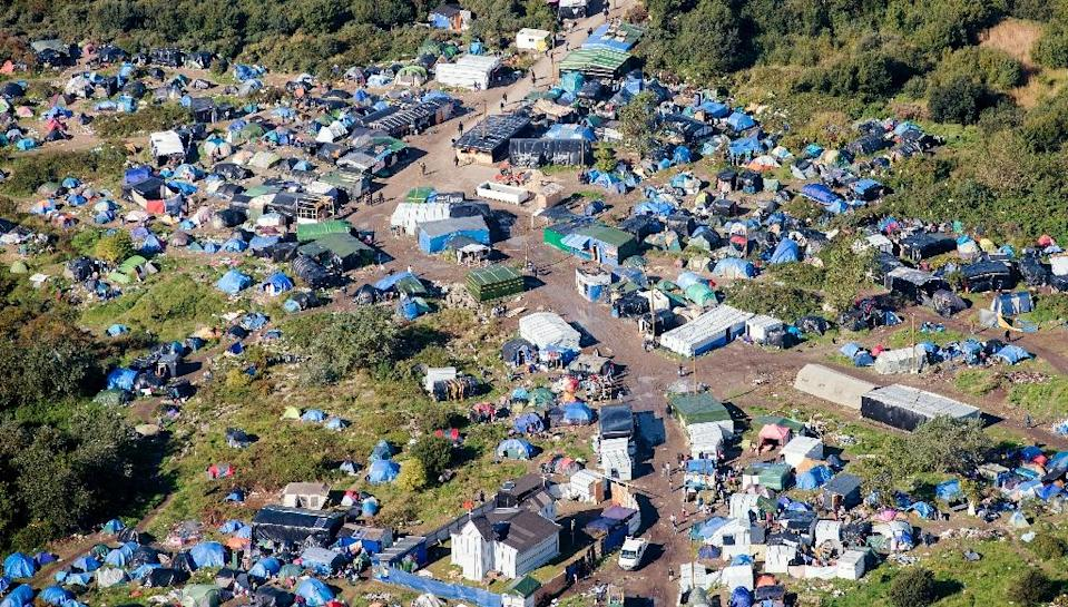 "An aerial picture taken on October 8, 2015 shows the ""New Jungle"" migrants camp where some 3,500 people live, near the port of Calais, northern France (AFP Photo/Denis Charlet)"