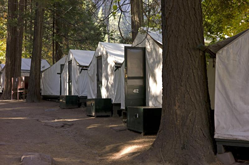 FILE -- In this file photo from Sunday Oct. 23, 2011, tents are seen in Curry Village in Yosemite National Park, Calif. On Monday, Aug. 27, 2012, Yosemite officials announced a second person had died of a rare, rodent-borne disease after staying in one of Yosemite National Park's most popular lodging areas, prompting federal officials to step up efforts to locate and warn recent visitors. (AP Photo/Ben Margot)
