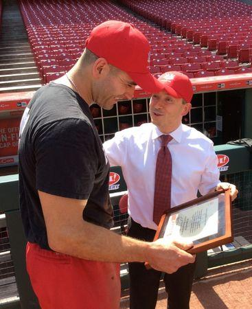 Canadian Trade Minister Francois-Philippe Champagne (R) presents an honorary certificate to Canadian baseball star Joey Votto, who plays for the Cincinnati Reds team, in Cincinnati, Ohio, U.S., June 16, 2017. Picture taken June 16, 2017. REUTERS/David Ljunggren