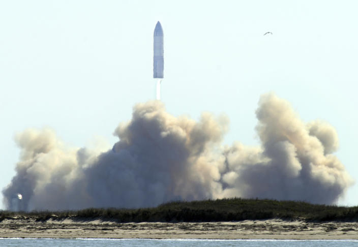 SpaceX's bullet-shaped Starship prototype lifts off for a successful test launch, Tuesday, Feb. 2, 2021, in Boca Chica, Texas. The test flight ended in a fiery crash when the Starship attempted to land. (Miguel Roberts/The Brownsville Herald via AP)