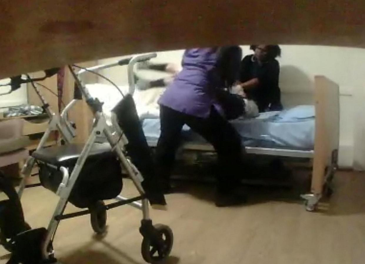 """The shocking video shows nurse Mamello Herring and care worker Maria Jackson dragging Angelina Lanera from the toilet back to her bed using a banned """"drag lift"""" technique. (SWNS)"""
