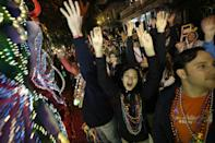 Revelers yell for beads and trinkets during the Krewe of Orpheus Mardi Gras parade in New Orleans, Monday, Feb. 11, 2013. (AP Photo/Gerald Herbert)