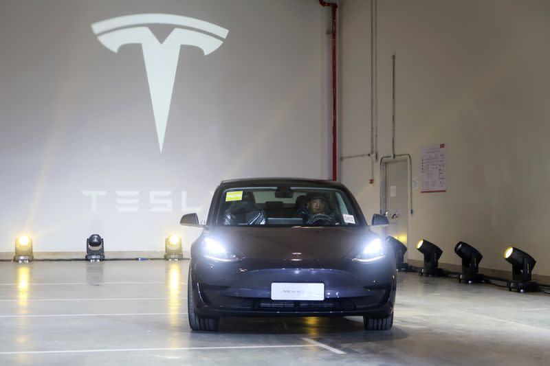 FILE PHOTO: China-made Tesla Model 3 vehicle is seen at a delivery ceremony in the Shanghai Gigafactory of the U.S. electric car maker