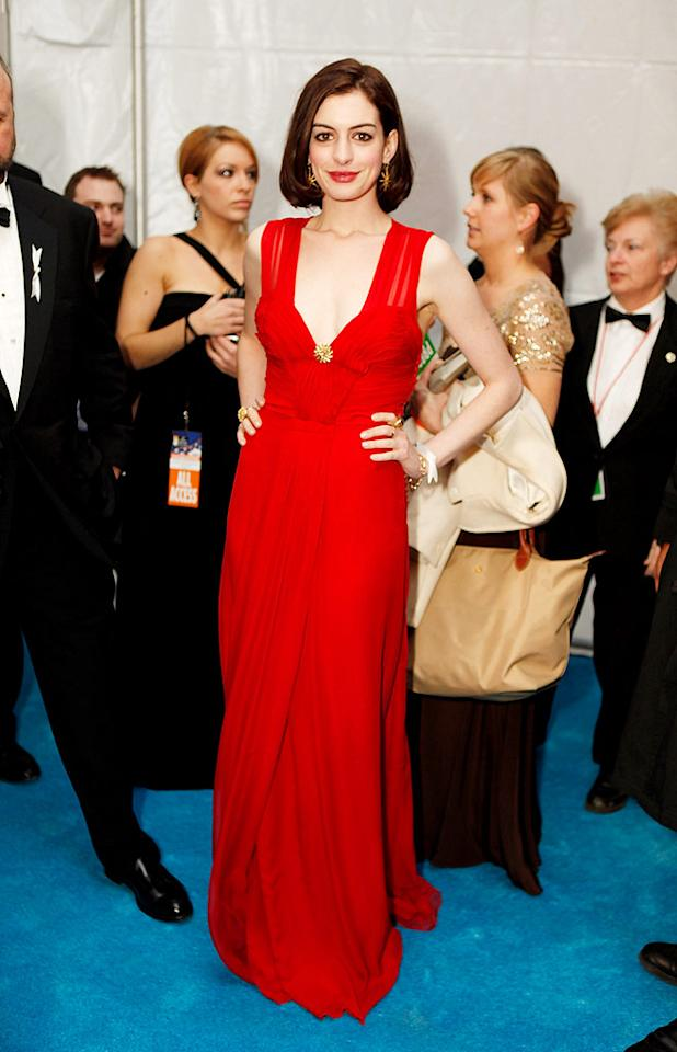 """Anne Hathaway looked ravishing in her ravishing red frock, matching lips, and freshly cropped coif. Jeff Vespa/<a href=""""http://www.wireimage.com"""" target=""""new"""">WireImage.com</a> - January 20, 2009"""