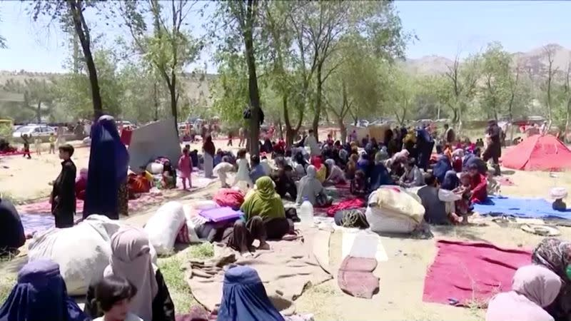 Families displaced by fighting sit in a park in Kabul, Afghanistan