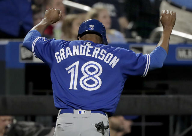 Toronto Blue Jays' Curtis Granderson (18) reacts as he heads to the dugout after scoring against the New York Mets during the third inning of a baseball game, Tuesday, May 15, 2018, in New York. (AP Photo/Julie Jacobson)