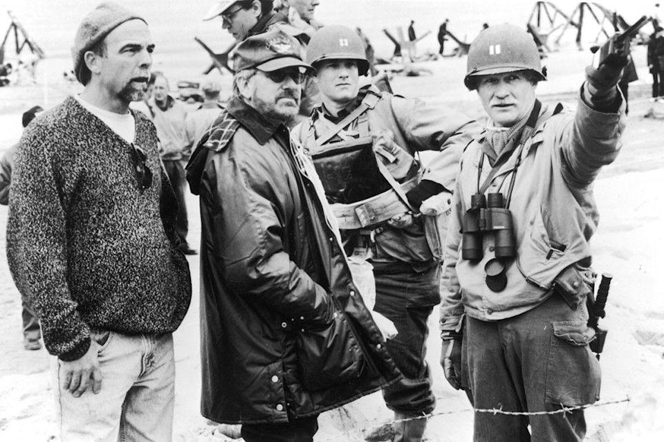 "<p>Steven Spielberg and Tom Hanks on the set of <em>Saving Private Ryan</em>. The actors reportedly went through an intensive <a href=""https://www.imdb.com/title/tt0120815/trivia"" rel=""nofollow noopener"" target=""_blank"" data-ylk=""slk:six-day boot camp"" class=""link rapid-noclick-resp"">six-day boot camp</a> before shooting began.</p>"