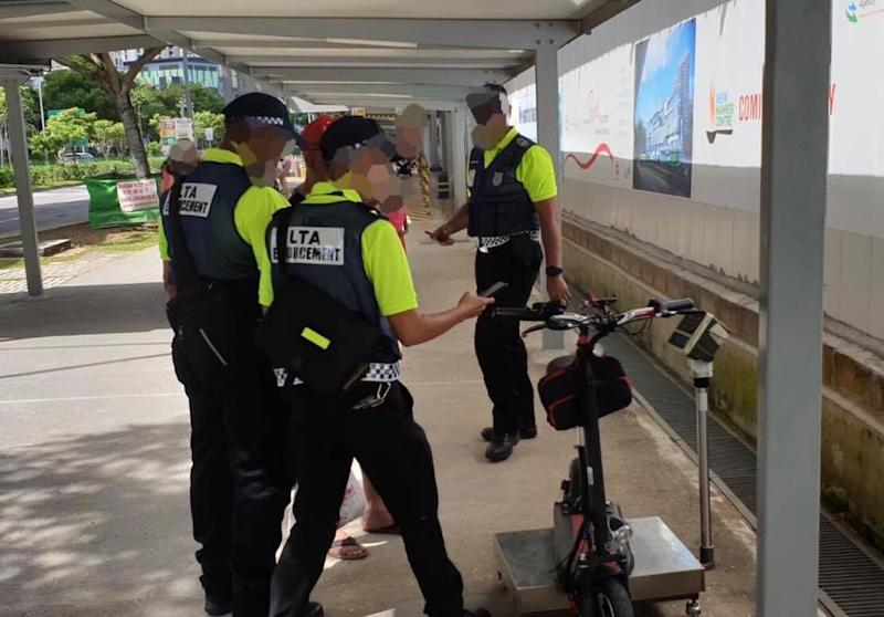 LTA officers catching an errant e-scooter rider on 1 January 2020, the first day of strict enforcement. (PHOTO: Land Transport Authority)