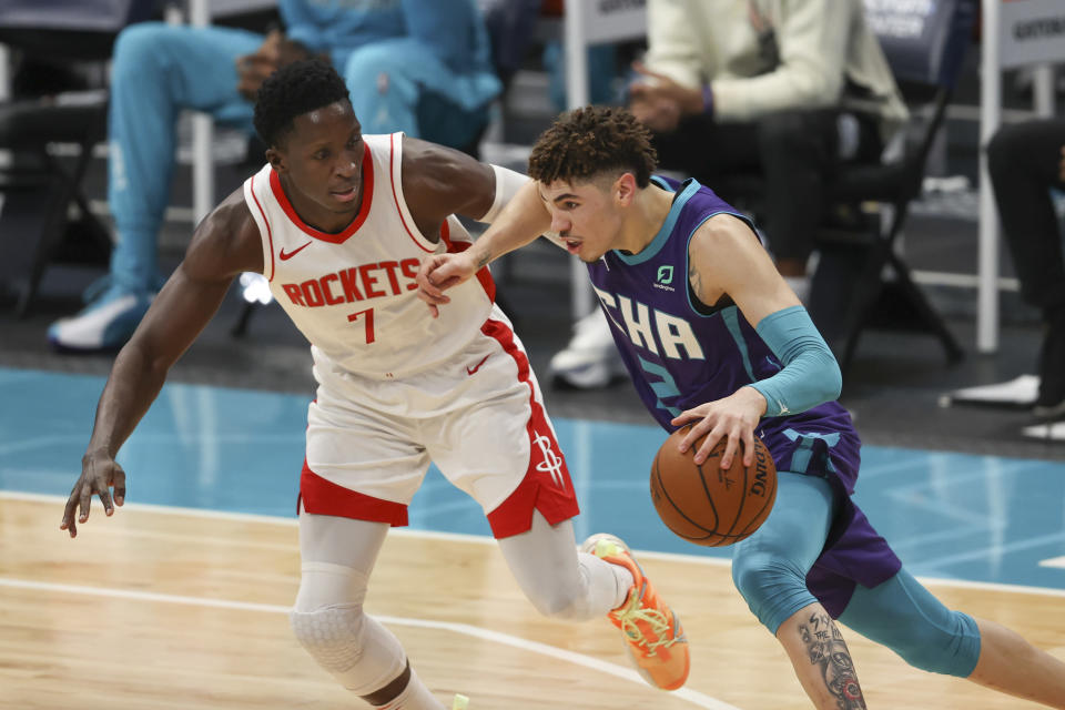 Charlotte Hornets guard LaMelo Ball, right, drives against Houston Rockets guard Victor Oladipo in the first half of an NBA basketball game in Charlotte, N.C., Monday, Feb. 8, 2021. (AP Photo/Nell Redmond)
