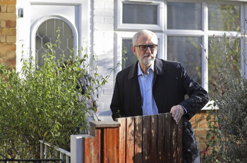 Leader of Britain's main opposition Labour Party, Jeremy Corbyn leaves his home in north London, Saturday Dec. 14, 2019. Corbyn has pledged to stand down from the party leadership following the collapse of the party vote in the recent general election and is under fire from within his own party. (Isabel Infantes/PA via AP)