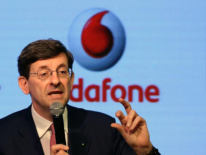 Vodafone Group CEO Vittorio Colao speaks during a news conference in Mumbai on March 20, 2017 (AFP Photo/PUNIT PARANJPE                      )