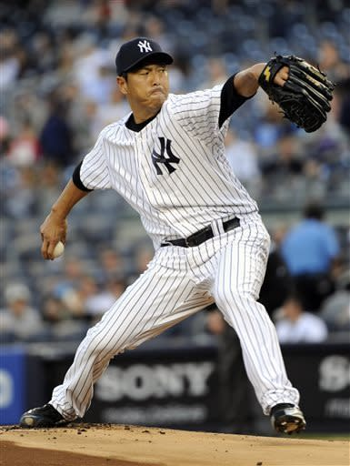 New York Yankees pitcher Hiroki Kuroda delivers the ball to the Toronto Blue Jays during the first inning of a baseball game Friday, May 17, 2013, at Yankee Stadium in New York. (AP Photo/Bill Kostroun)
