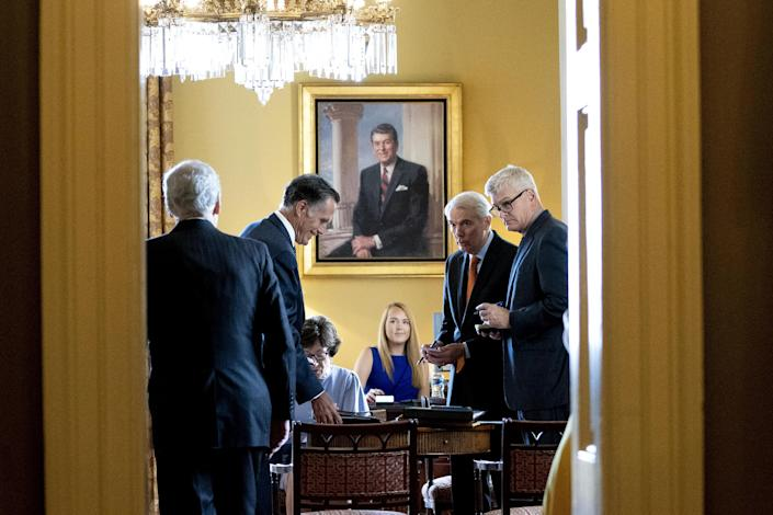 Senate Minority Leader Mitch McConnell meets with Senators Mitt Romney, Susan Collins, Rob Portman, Bill Cassidy and Lisa Murkowski gather in McConnell's office at the Capitol on Wednesday, July 28, 2021. / Credit: Stefani Reynolds/Bloomberg via Getty Images