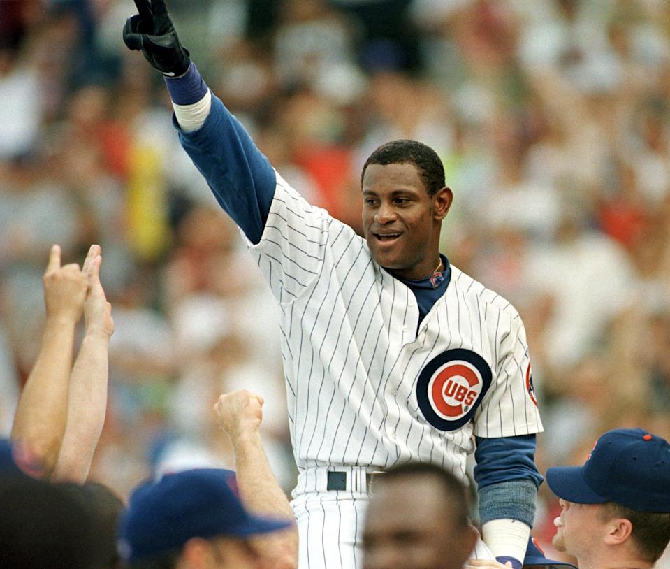 Sammy Sosa celebrates his 62nd home run in 1998. (JOHN ZICH/AFP via Getty Images)