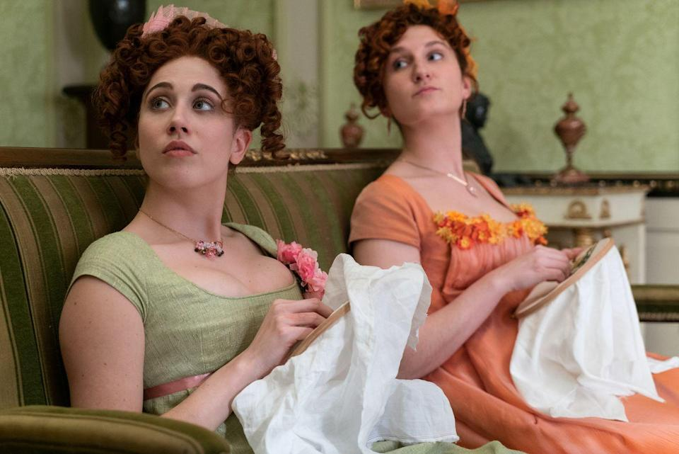 <p>Philippa, on the left and often easy to identify throughout the series by her closet full of green frocks, is the middle Featherington daughter, whose sole focus is landing a husband. The woman behind the lime-hued wardrobe is Cains, who has held recurring roles in British series including <em>Marcella</em>, <em>Safe House</em>, and <em>In the Flesh</em>. </p>