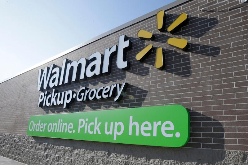 A sign is displayed at a Walmart Pickup Grocery location in Bentonville, Ark., Thursday, June 4, 2015. (AP Photo/Danny Johnston)